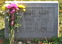 "Photo of James Allen Lloyd's tombstone, reading ""James Allen, son of Thomas Jay Lloyd. April 25, 1977 to November 25, 1981."""