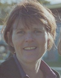 Photo of Janene Devine, a middle-aged white woman with short brown hair.