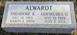 "Photo of the gravestone of Gertrudes Alwardt. It reads, ""Alwardt, Theodore R, Gertrudes G."", and gives birth and death dates for both."