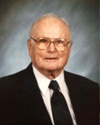 Photo of Theodore Meyer, an elderly white man in a suit and black tie, wearing glasses.