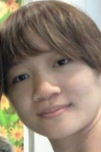 Closeup photo of Annie Ee, a young woman with brown hair, pale skin, and dark brown eyes.