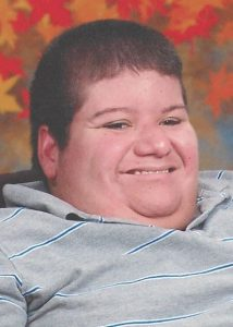 Photo of Jeffrey Kittredge II, a heavyset man with fair skin and short brown hair, smiling broadly.
