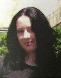 Photo of Jody Hernandez. She has fair skin and long wavy dark-brown hair.