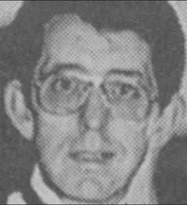 Black and white newspaper photo of Henry Wilson, a middle-aged man with dark hair, light skin, and glasses.