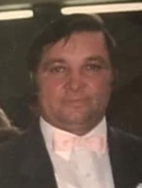 Photo of Zvonimir Petrovski, a middle-aged man with dark brown hair and light skin, wearing a suit with a pink bow tie.