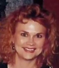 Photo of Susan Winters. She is a woman with pale skin and curly strawberry-blonde hair.