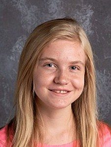 Portrait photo of Jessica Cunningham, a teenage girl with long blonde hair and fair skin, wearing a peach T-shirt.