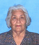 Photo of Rita Morales. She is an elderly woman with gray hair and light-brown skin, wearing a brown collared shirt.