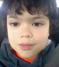 Photo of Julian Pintar. He is a young boy with dark hair and dark brown eyes.