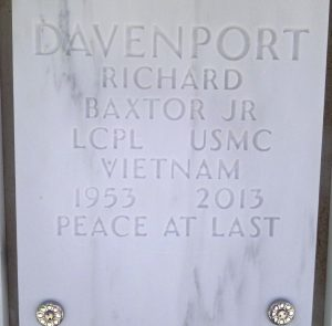 "Richard Davenport's gravestone. It reads, ""Davenport, Richard Baxtor Jr. Lcpl USMC Vietnam. 1953-2013. Peace at last."""