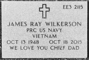 Photo of a gravestone. It reads: EE3. James Ray Wilkerson. PRC US Navy. Vietnam. Oct 13 1948. Oct 18 2015. We love you Chief Dad.