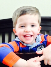 Photo of Tyler Bryan, a toddler boy with fine brown hair and fair skin.