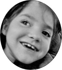 Photo of Jacee Sanner, in black and white. The photo is cropped so that just her face can be seen. Jacee is a young girl with fair skin. She is smiling and looking away to the side.