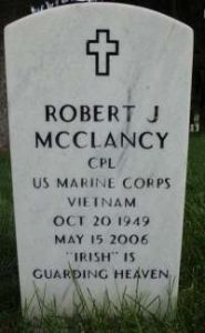 "Photo of a gravestone. It reads: Robert J McClancy. Corporal, US Marine Corps. Vietnam. Oct. 20, 1949. May 15, 2006. ""Irish"" is Guarding Heaven."""