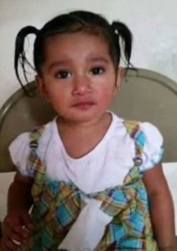 Photo of Leslie Ramirez. She is a small girl with tan skin and dark brown hair pulled into two ponytails.