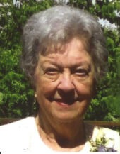 Photo of Marilyn Miller, a woman with short white hair and fair skin, photographed outdoors.