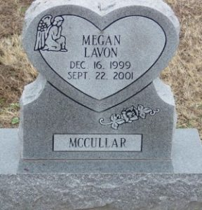 "A heart-shaped gravestone reading, ""Megan Lavon. December 16, 1999 to September 22, 2001. McCullar."""