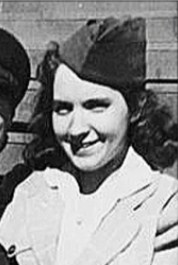 Black and white photo of Leona Twiss, a young woman in old-fashioned clothing. She has curly hair and light skin and is wearing a white blouse and flight attendant's cap.