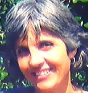 Photo of Annette Bouwer, a middle-aged woman with pale skin and short gray hair.