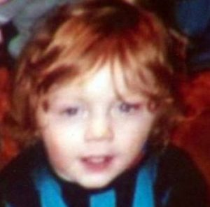 Photo of a toddler with bright red hair.