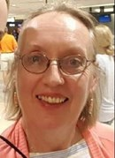 Photo of Marcia Neigebauer, a woman with fair skin, blonde hair, and glasses.