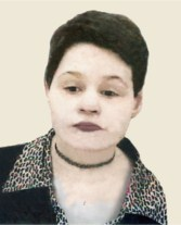 Photo of Andrea Bartlett, a young woman with very pale skin and red lips, her hair in a boy cut, wearing a choker and jacket with an animal print collar.