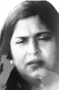 Black and white photo of a woman with straight, dark hair and a puzzled expression on her face.