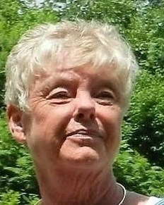 Photo of Lorene, an older lady with white hair, photographed outdoors.