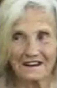 Blurry photo of a white-haired old lady with pale skin.