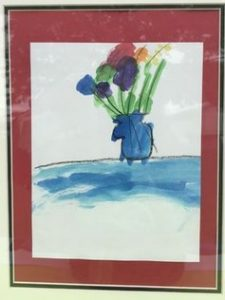 Child's watercolor painting of brightly colored flowers in a blue vase.