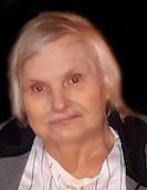 Photo of an older man with shaggy hair.